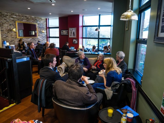 Extended family filling much of Cafe Nero's upstairs before the memorial service