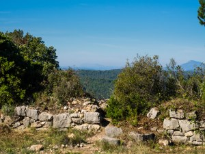 Part of the outer wall, with Mt Sainte-Victoire just visible in the distance