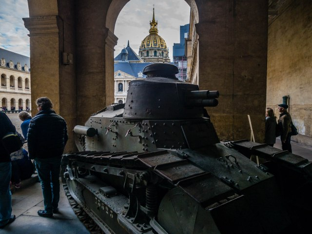 Old tank on display. Napoleon is buried under the great dome in the background.