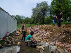 Courmettes volunteers helping to build a stone wall