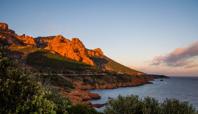 the Esterel from the coast road at sunset with very orange/red rocks